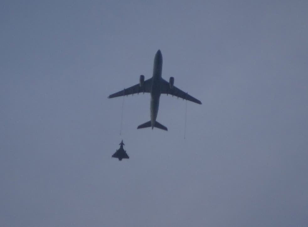 An RAF Voyager refuelling aircraft and Typhoon jet during an operation to intercept a civilian plane on 7 March