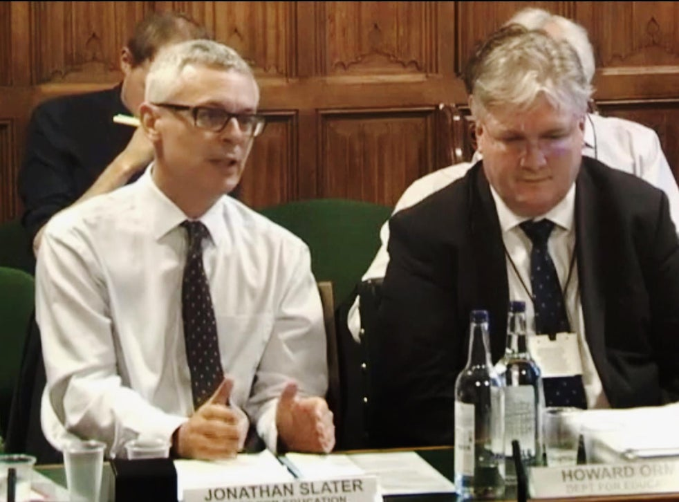 Jonathan Slater (left) gives evidence to a House of Commons committee