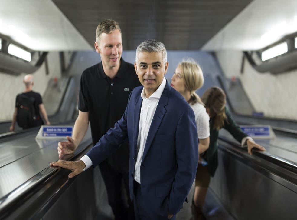 London mayor Sadiq Khan, having a good stand on the right of an escalator.