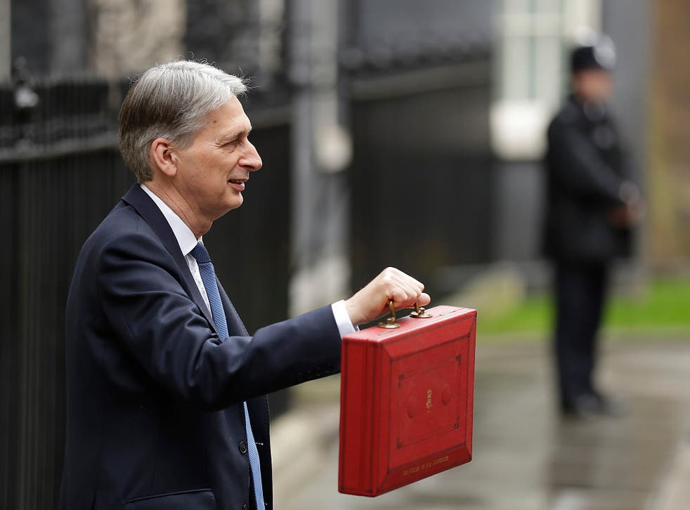 Chancellor Philip Hammond holds the red dispatch box on budget day