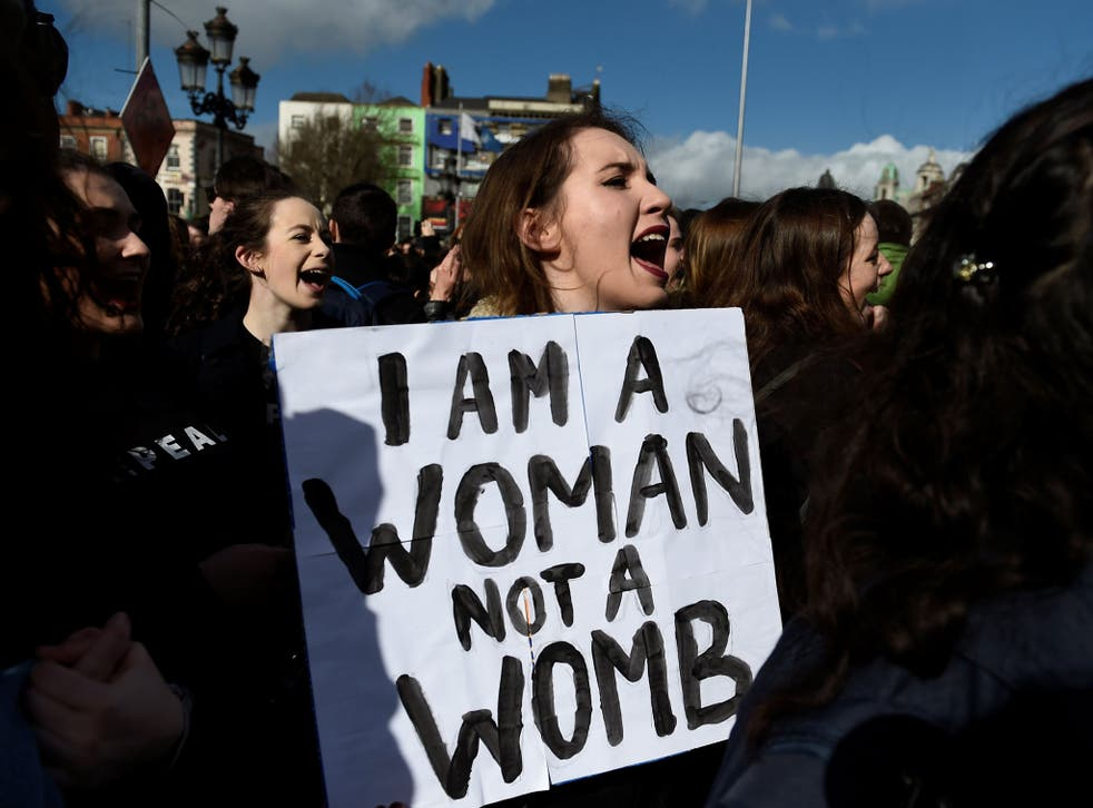 Campaigners stage a protest to demand more liberal abortion laws in Dublin