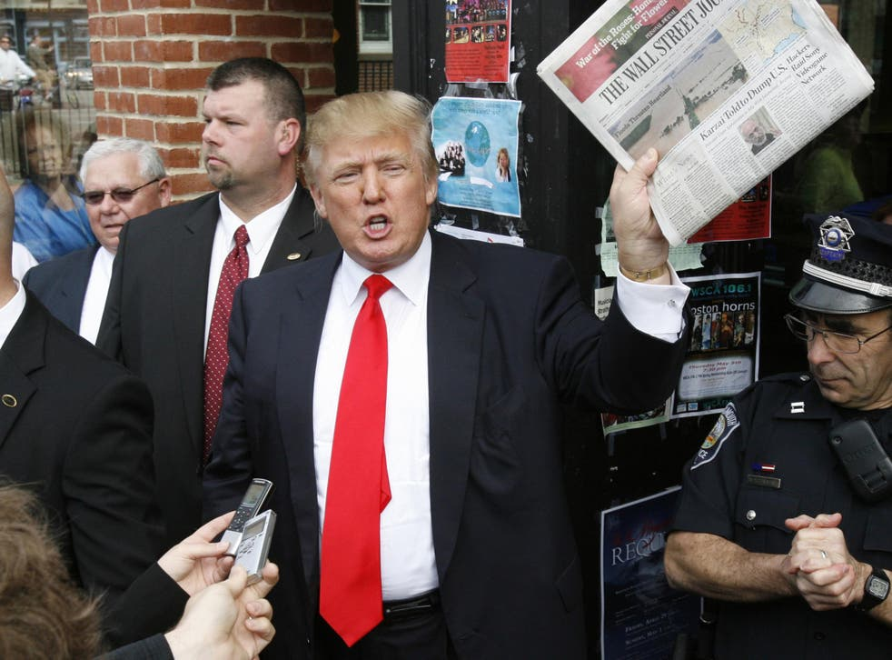 The President brandishing a copy of the Wall Street Journal on the campaign trail