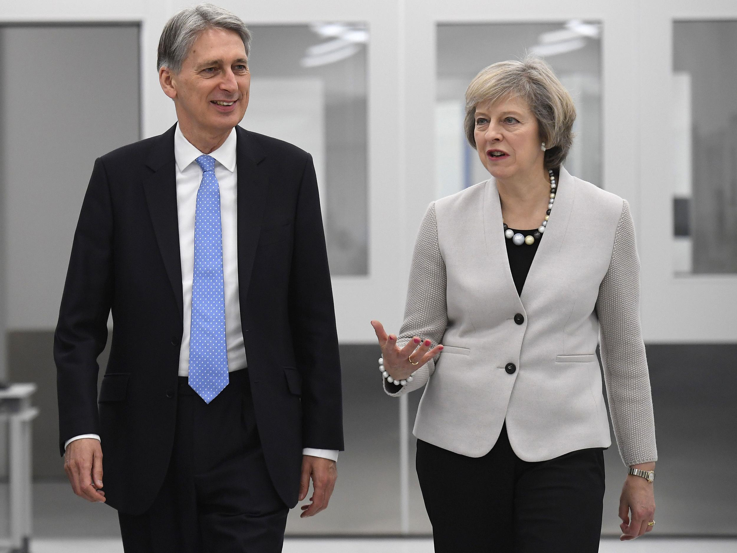 Theresa May slaps down Chancellor after he claimed Brexit divorce bill would be paid even without a trade deal