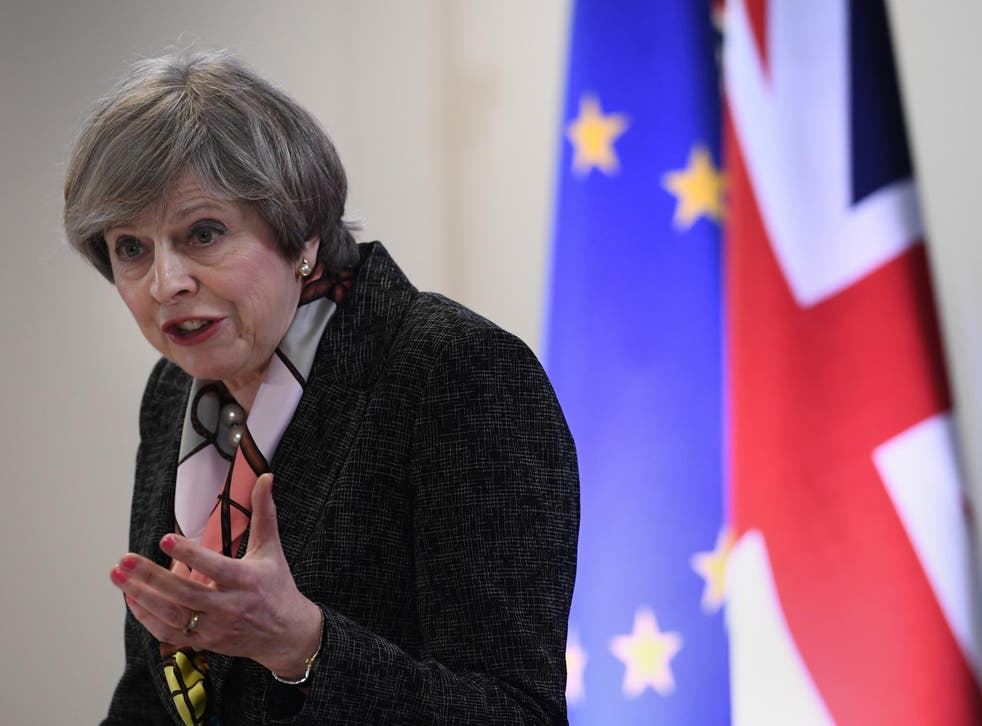 Theresa May speaks during a press conference at the Council of the European Union, during an EU summit in Brussels