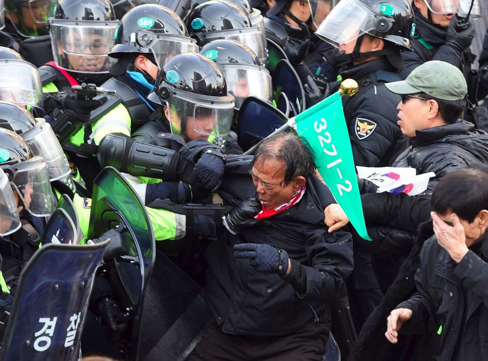 South Korean supporters of Park Geun-Hye clash with police after the announcement of the Constitutional Court ruling over her impeachment, in Seoul on 10 March, 2017