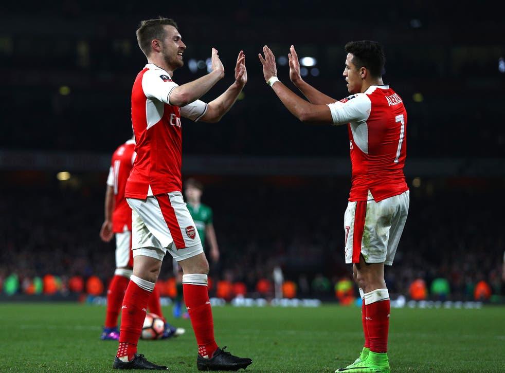 Aaron Ramsey congratulates Alexis Sanchez on his goal