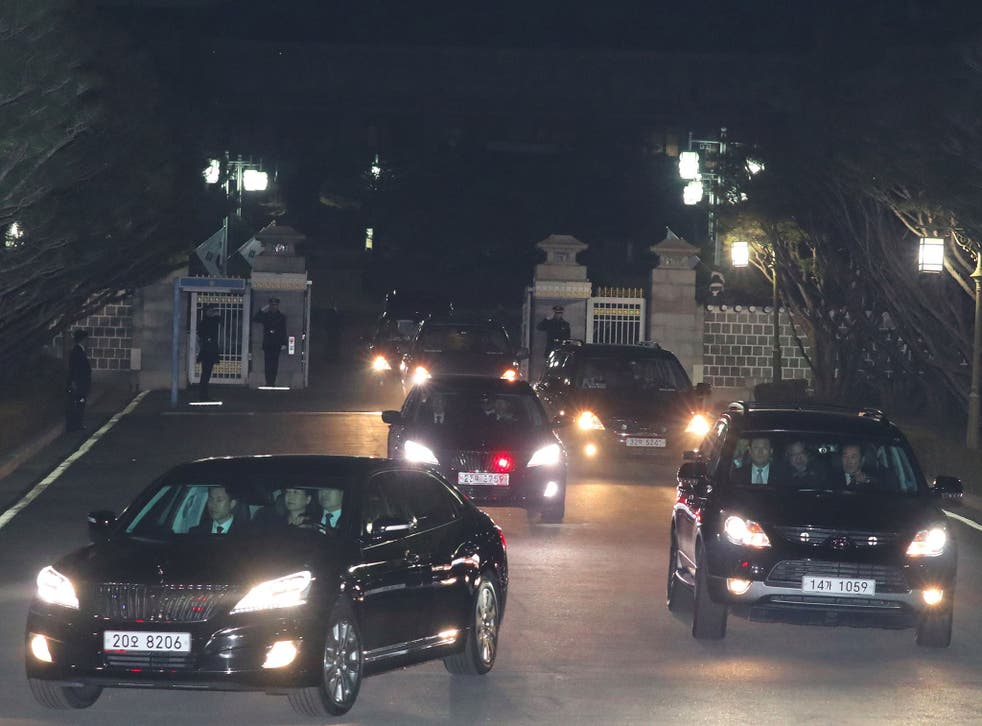 A car (L front) carrying South Korea's impeached ex-president Park Geun-Hye (C in the car) leaves the presidential Blue House in Seoul on 12 March, 2017