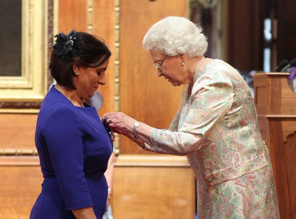 Detective Constable Nighat Hubbard is made an MBE by the Queen in July 2014