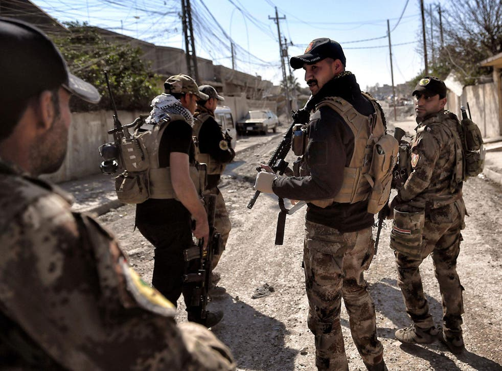 Iraqi troops patrol at retaken areas in west Mosul as they advance in the city in the ongoing battle to seize it from Isis jihadists
