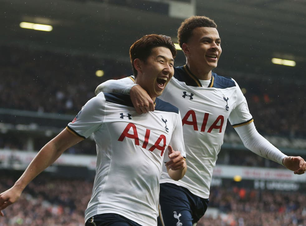 Son Heung-min celebrates with Dele Alli after scoring his second goal for Spurs against Millwall