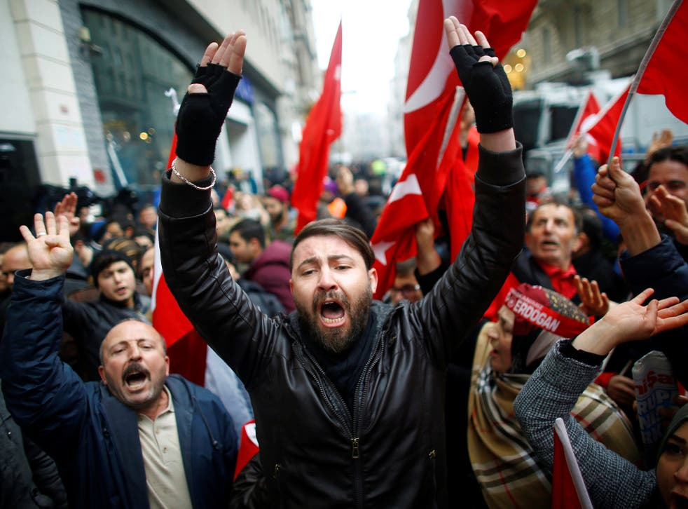 Turkish supporters of President Erdogan protest outside the Dutch Consulate in Istanbul