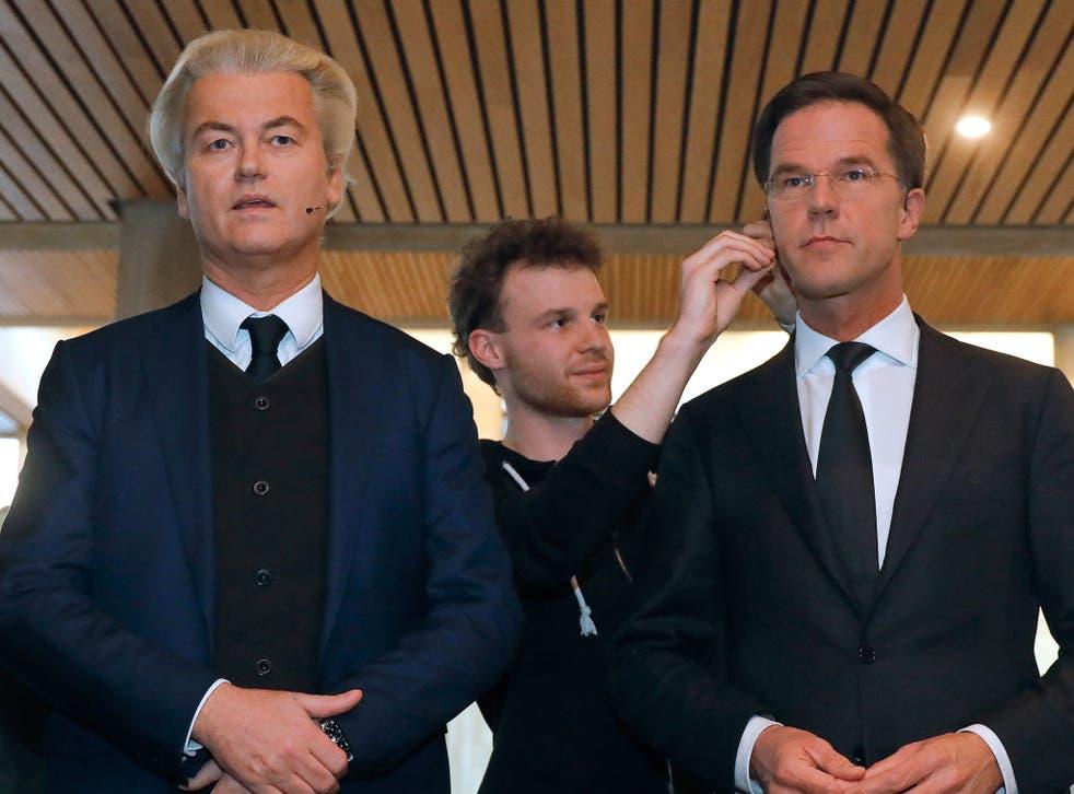 Geert Wilders and Mark Rutte get their microphones installed before the televised debate