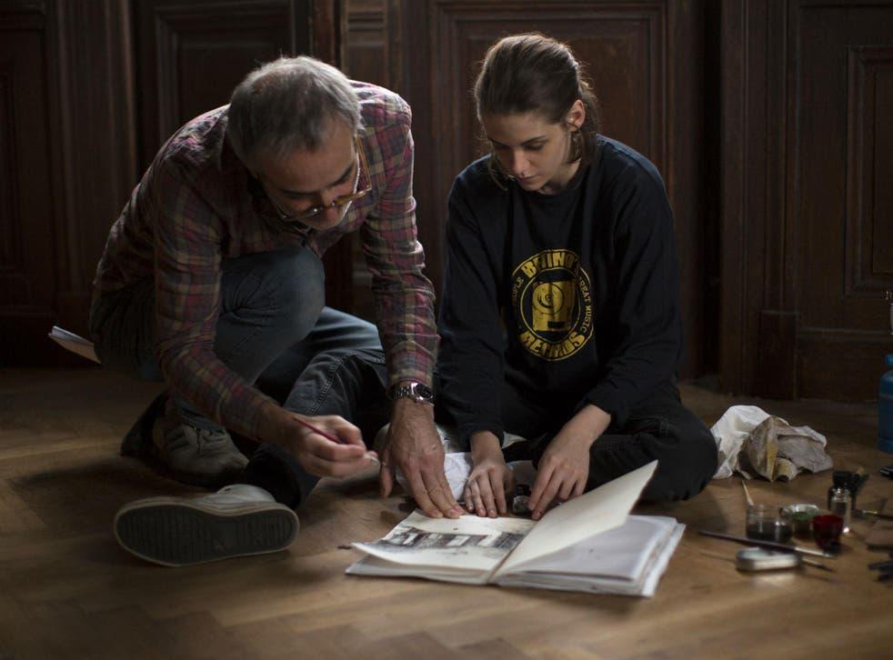 The film director Olivier Assayas and Kristen Stewart on set of 'Personal Shopper'