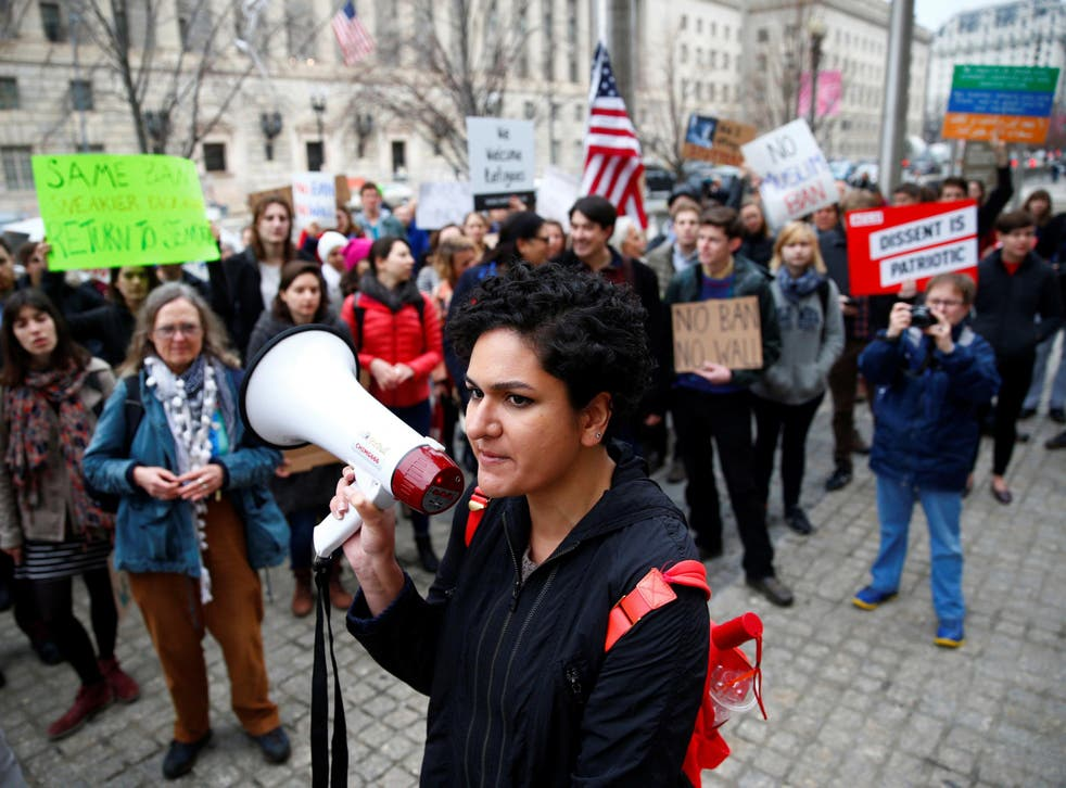 Immigration activists, including members of the DC Justice for Muslims Coalition, rally against the Trump administration's new ban against travelers from six Muslim-majority nations outside of the US Customs and Border Protection headquarters in Washington
