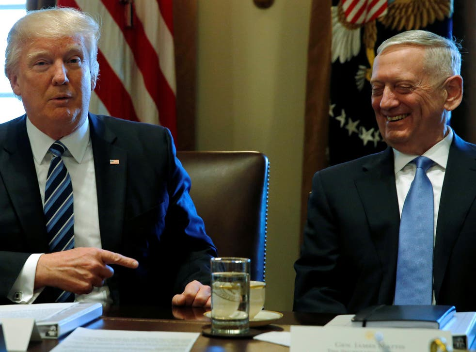 President Donald Trump chairs a Cabinet meeting at the White House in Washington, flanked by General James Mattis
