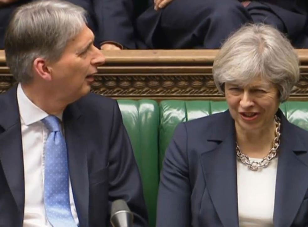 Chancellor Philip Hammond  and Prime Minister Theresa May listen to Shadow Chancellor John McDonnell speaking in the House of Commons