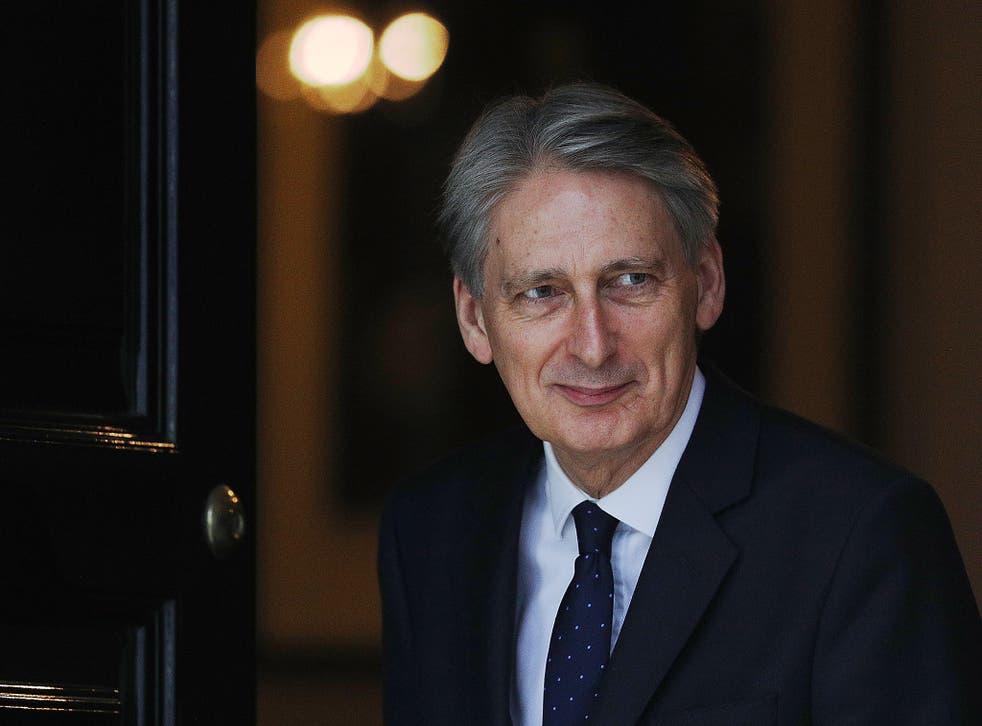Chancellor Philip Hammond walks out of 11 Downing Street to greet the US Secretary of the Treasury Steven Mnuchin