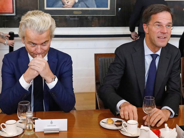 Dutch Prime Minister Mark Rutte (R) of the VVD Liberal party and Dutch far-right politician Geert Wilders of the PVV Party