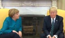 Donald Trump refuses to shake Angela Merkel's hand