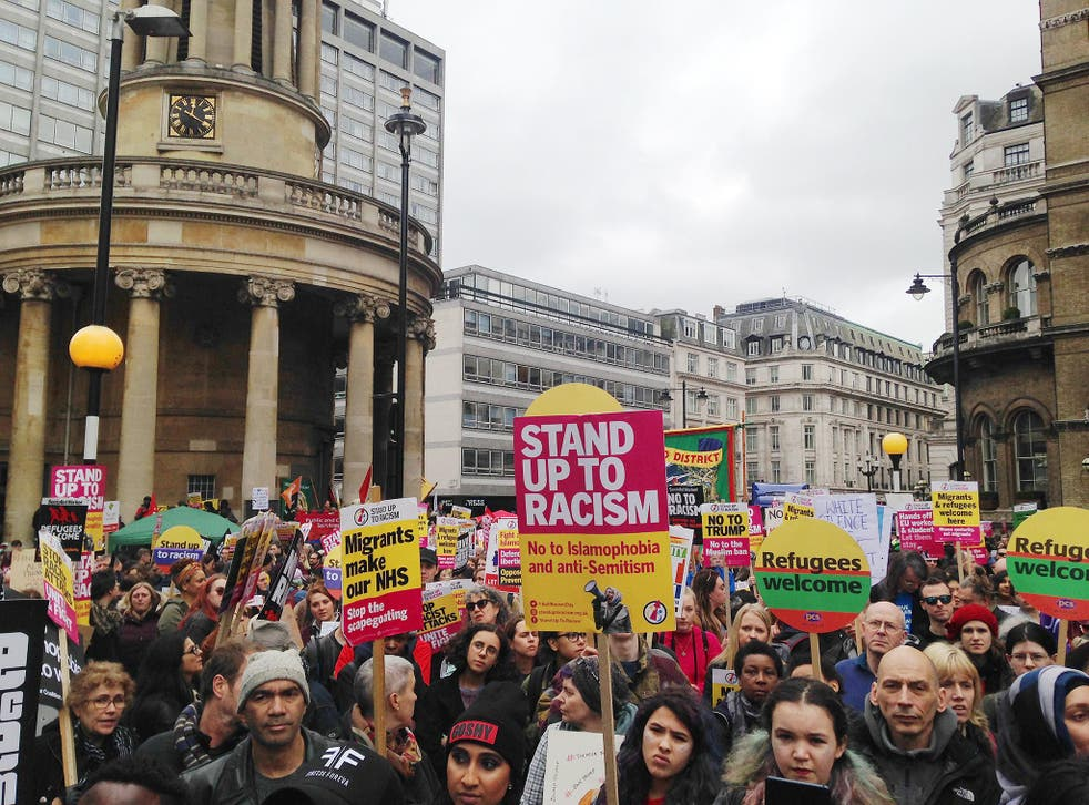 Protesters arrived at Portland Place in Central London at around midday holding banners adorning defiant messages of solidarity