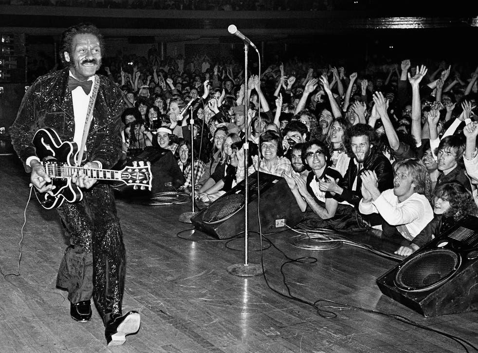 Rock'n'roll legend Chuck Berry struts his signature 'duck walk'