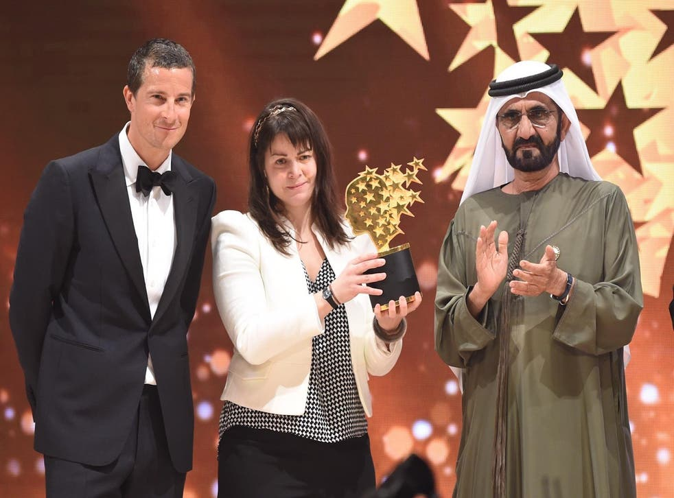 Maggie MacDonnell with United Arab Emirates Vice President, Sheikh Mohammad Bin Rashid Al Maktoum, and Bear Grylls - who delivered the trophy via helicopter
