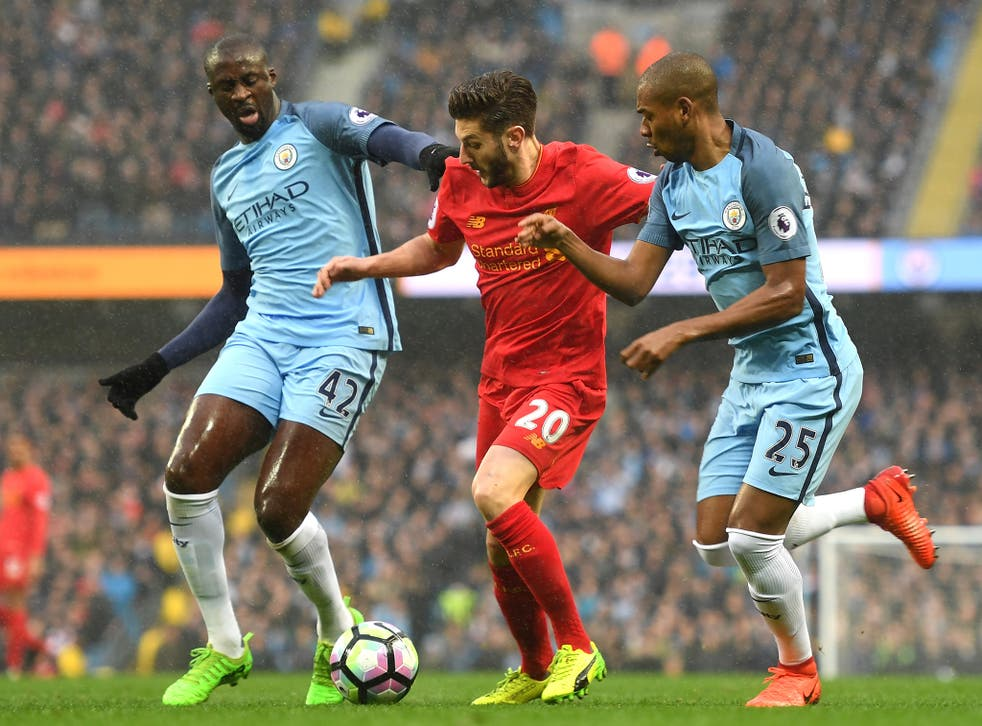 Adam Lallana glides past Yaya Toure and Fernandinho in the opening stages