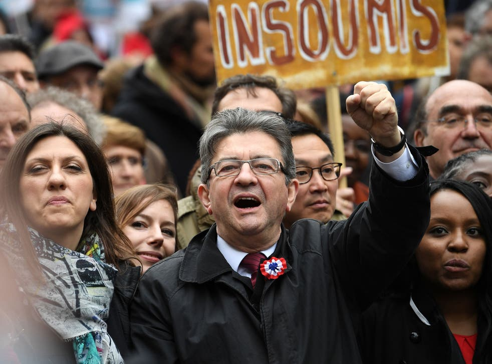 French presidential election candidate for the far-left coalition 'La France insoumise' Jean-Luc Melenchon raises his fist as he takes part in the March for the 6th Republic