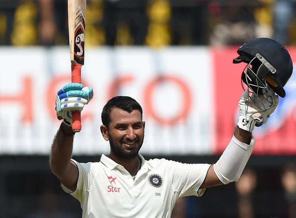 Pujara celebrates his historic innings