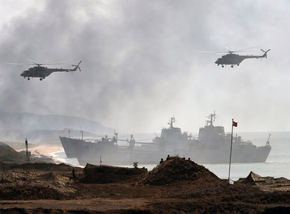 Russia's navy ships and helicopters take part in a military exercise off the coast of the Black Sea in Crimea in September 2016
