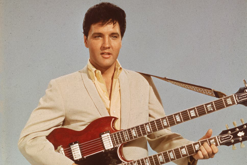Elvis impersonator running for congress in arkansas the independent portrait of american singer and actor elvis presley 1935 1977 as he holds fandeluxe Choice Image