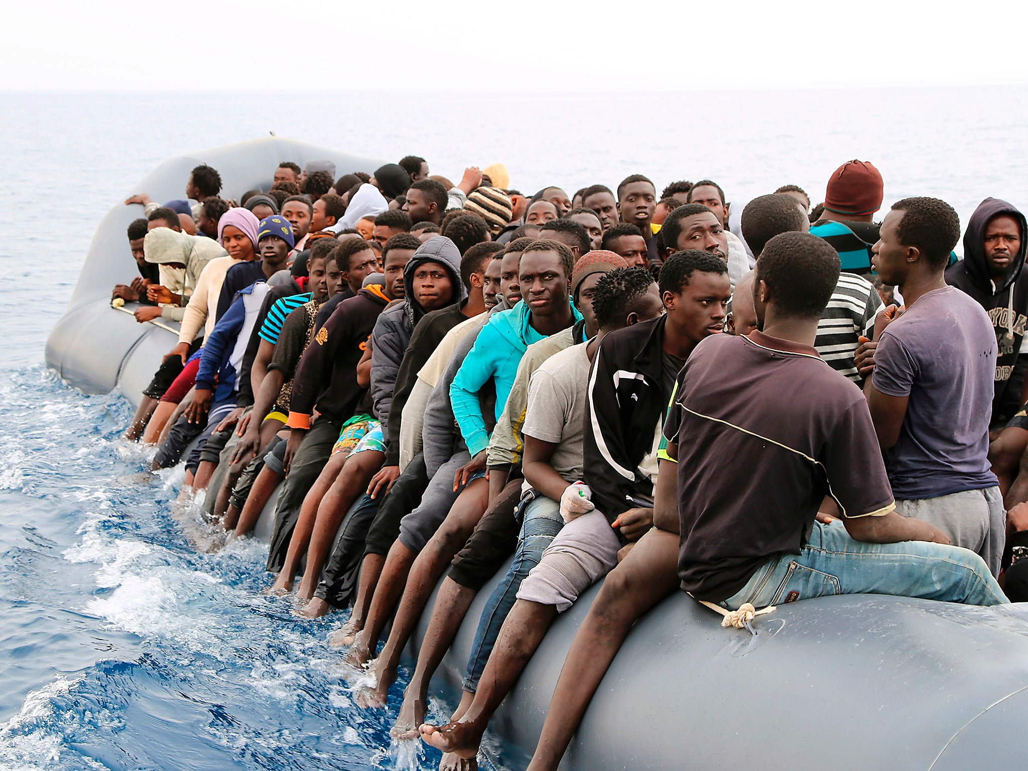 Libyan Slave Trade >> Libyan court suspends deal struck with Italy aiming to reduce refugee boat crossings over ...