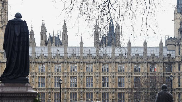 An air ambulance lands after gunfire sounds were heard close to the Palace of Westminster in London