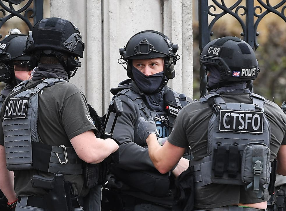 Armed police outside the Houses of Parliament