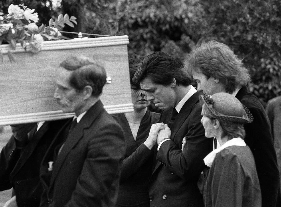 Jeremy Bamber (centre) appears grief-stricken at the funeral in 1985 of his adoptive parents, Nevill and June, and sister Sheila. He was later convicted of the murder of all three, as well as that of Sheila's six-year-old twin sons
