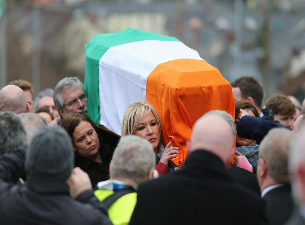 Sinn Fein's Gerry Adams and Michelle O'Neill carrying Martin McGuinness's coffin