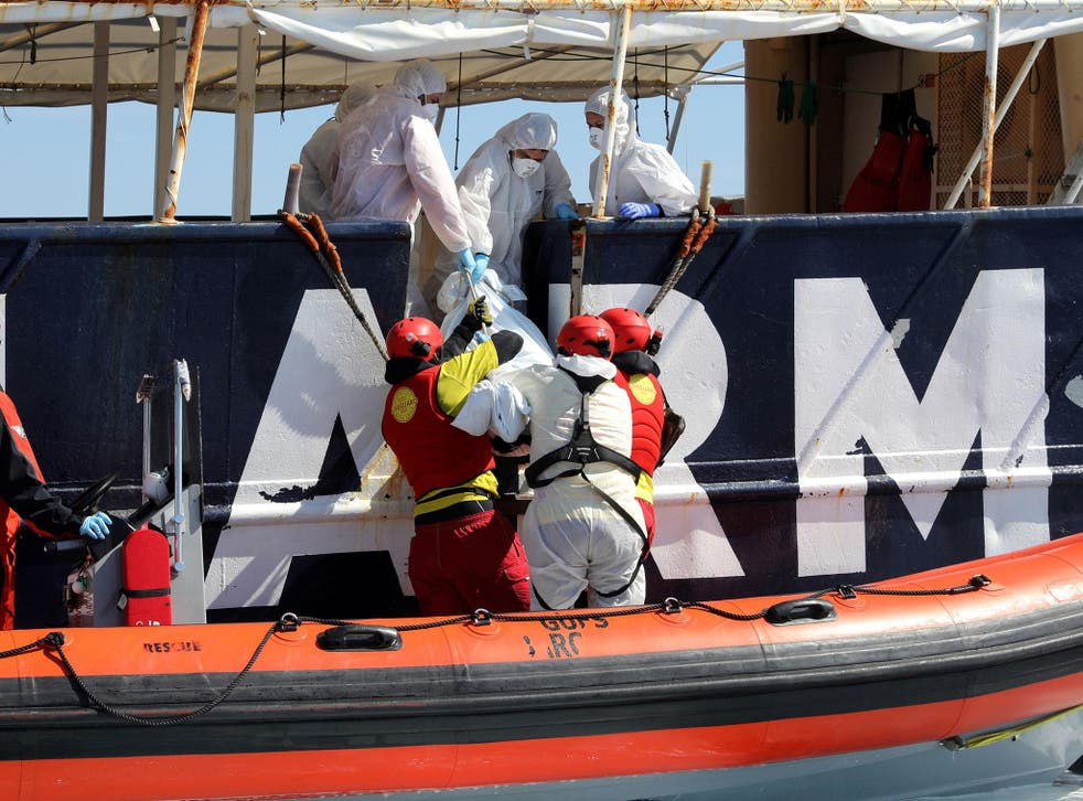 Lifeguards from Proactiva Open Arms lift a body into Golfo Azzurro