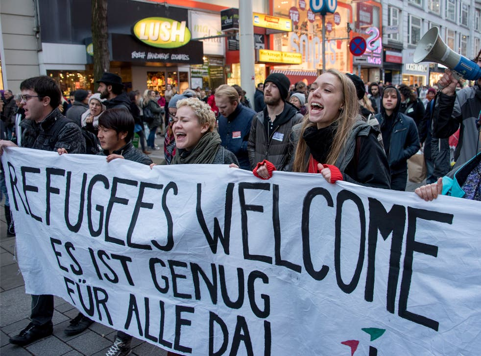 Austrian citizens and asylum seekers march during a pro-refugee protest called 'Let them stay' in Vienna, Austria, in November 2016.