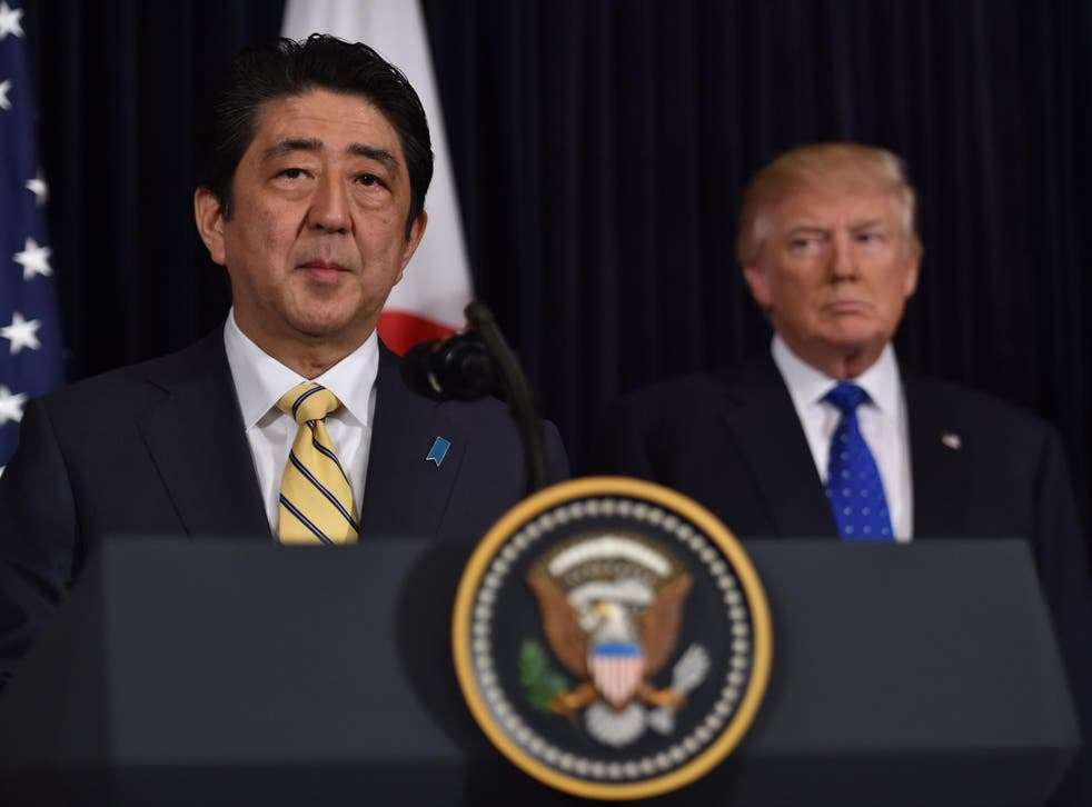 Japanese Prime Minister Shinzo Abe (L) and US President Donald Trump speak at Trump's Mar-a-Lago resort in Palm Beach, Florida, on February 11, 2017