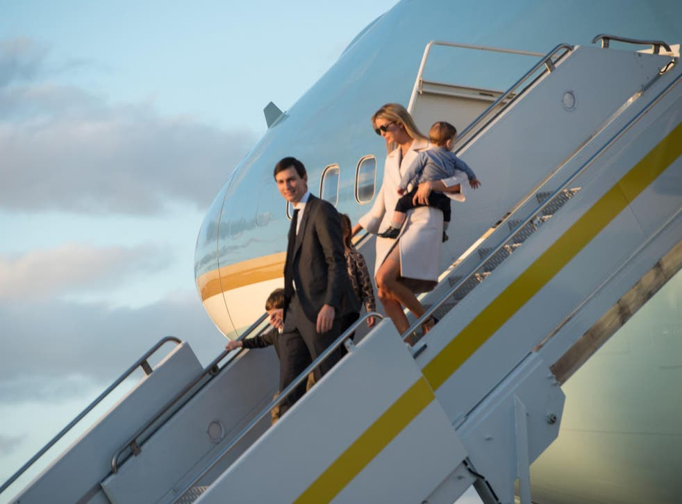 Ivanka Trump, daughter of US President Donald Trump, her husband Jared Kushner, senior adviser to Trump, and their children walk off Air Force One at Palm Beach International Airport in Florida
