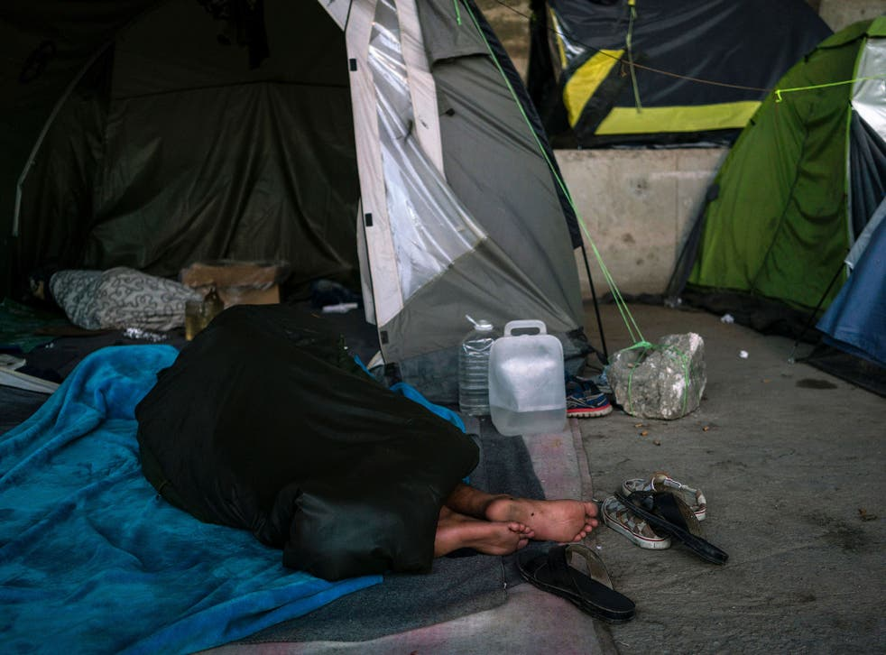 More than 1,500 migrants are living around the Greek port of Piraeus