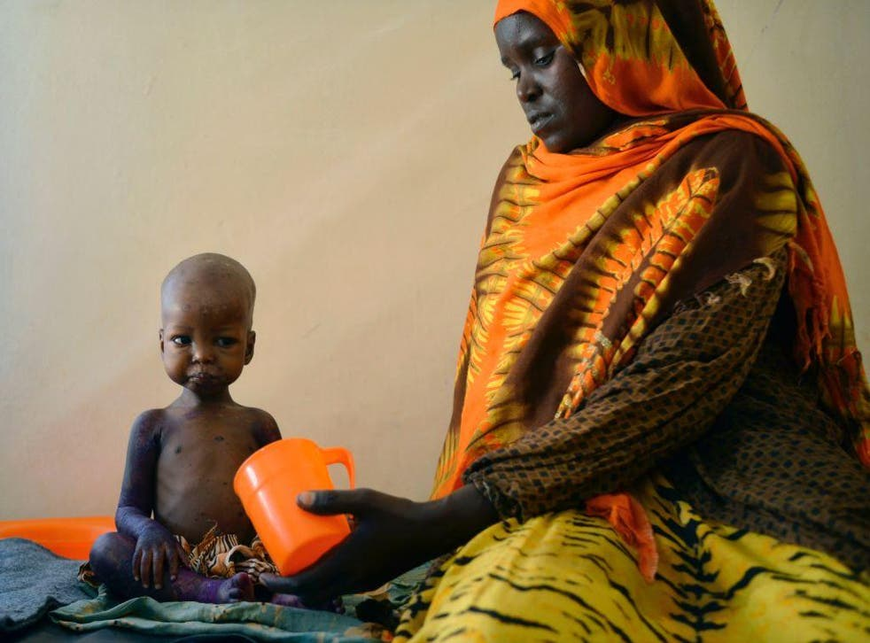 A child is fed a special formula by her mother at a hospital in Baidoa, Somalia, where drought is causing severe malnourishment
