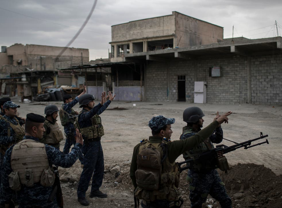 Federal Police soldiers fight against Isis in west Mosul