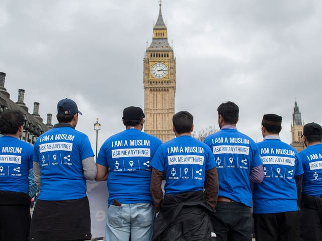 Members of the Ahmadiyya Muslim Association pay their respects in Parliament Square a week after the Westminster terror attack