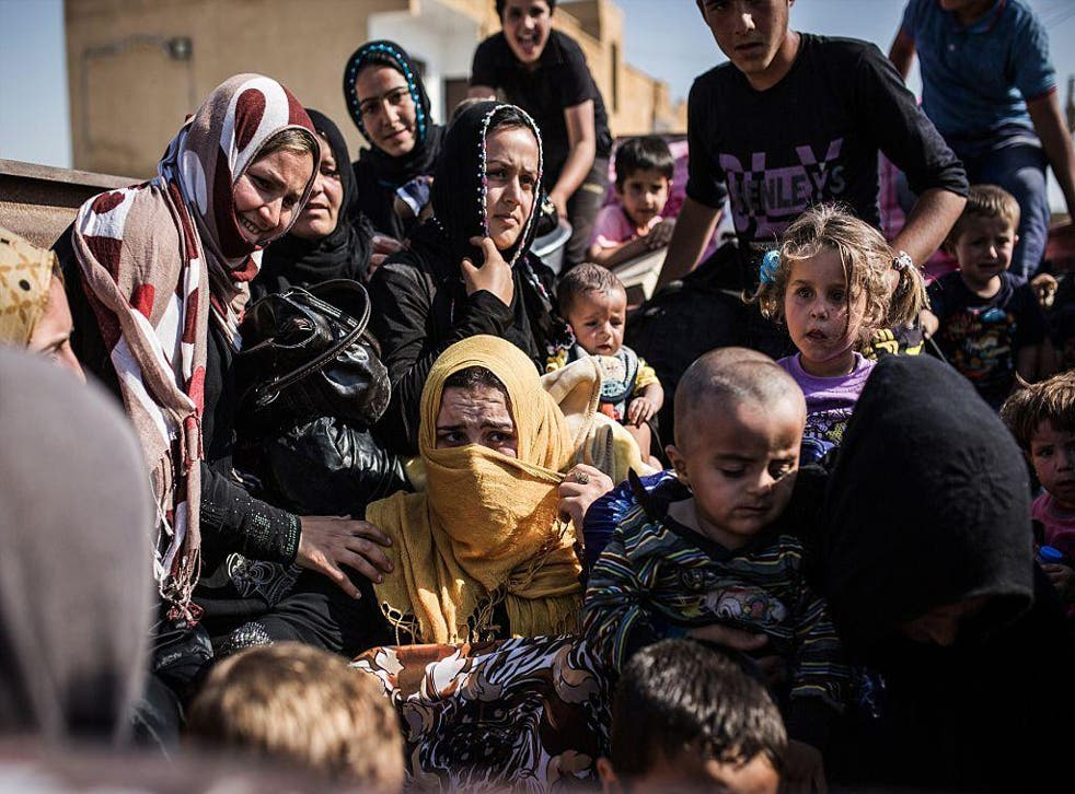 Syrian refugees from Raqqa governorate cross the Syria-Turkey border fleeing Isis in this file photo dated June 22 2015