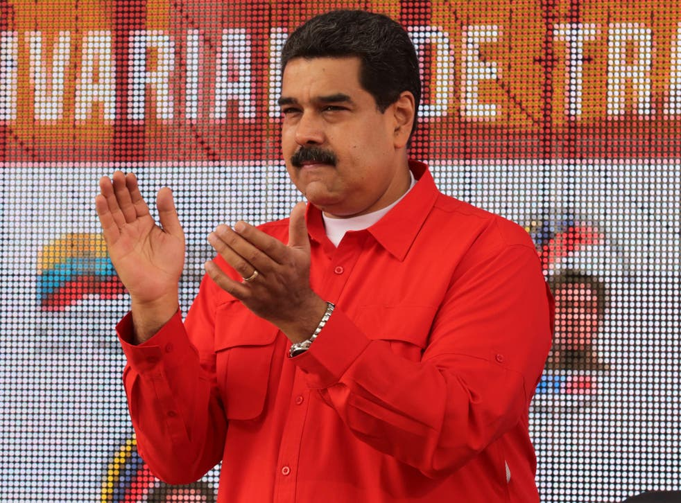 Venezuela's President Nicolas Maduro applauds as he attends a pro-government rally with workers in Caracas on March 18 2017