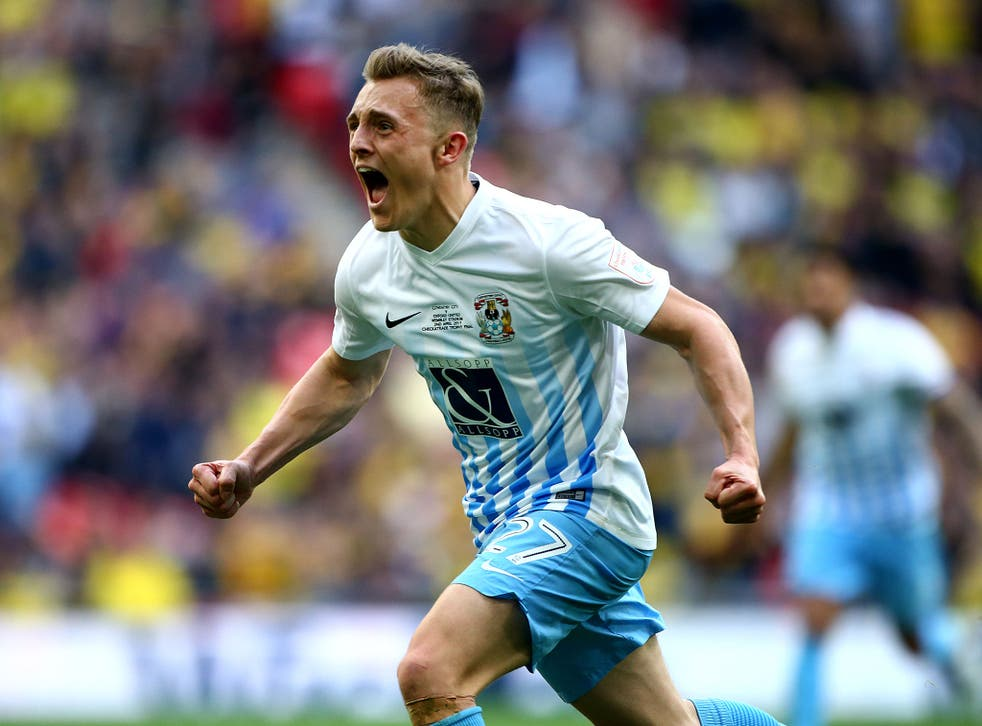 George Thomas celebrates after scoring Coventry's second goal in the EFL Checkatrade Trophy Final