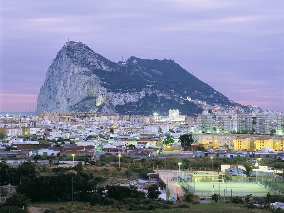 Inside the drug capital of spain and the gateway for illicit la lnea seen here in the foreground with the rock of gibraltar behind has fandeluxe Images