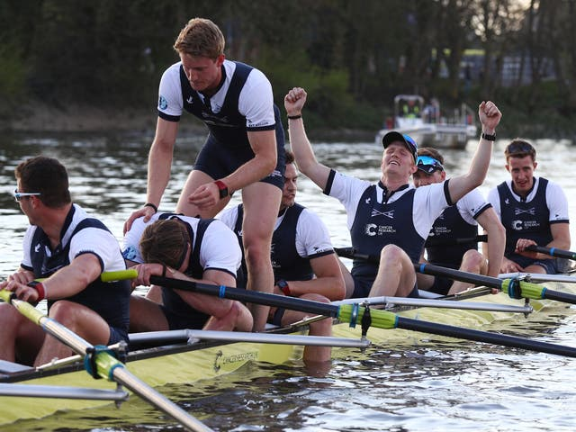 Oxford's team celebrate after crossing the line