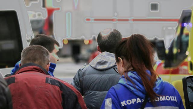 An injured person is helped by emergency services outside Sennaya Ploshchad metro station, following explosions in two train carriages at metro stations in St. Petersburg